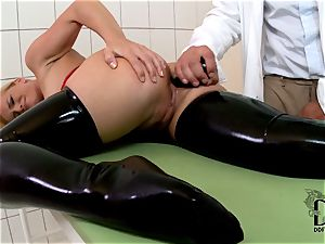 harsh towheaded in latex dildoed by the doctor