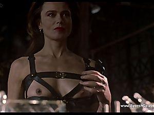 brunette Lena Olin in underwear shows off her diminutive bosoms