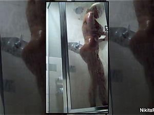 Home movie of Nikita Von James taking a shower