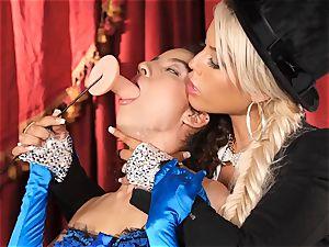 Bridgette B puts molten secretary Lana Lovelace through her paces