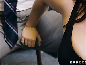 tutor Angela white filled nut sack deep in her classroom