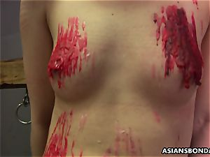 chinese cockslut loves to be bdsm treated to a paraffin wax demonstrate