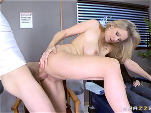 blondie milf Julia Ann deep-throats a meaty bone as his fucking partner sleeps